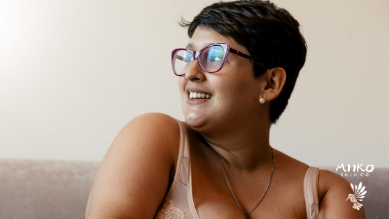 short hair woman with glasses smiling