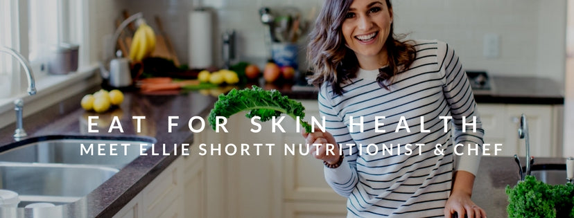 eat for skin health meet ellie shortt nutritionist and chef - girl in kitchen holding kale and smiling