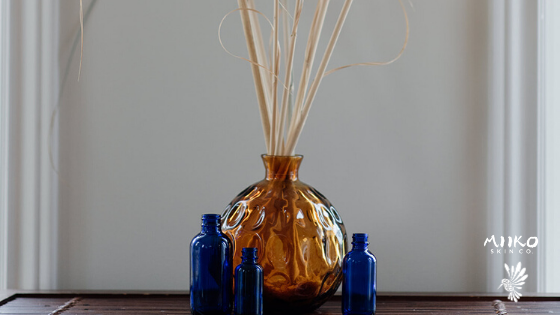 blue bottles and flowers in amber vase