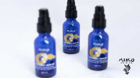 blue serum bottles against white background