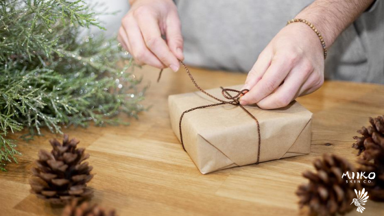 sustainably wrapping a gift with craft paper