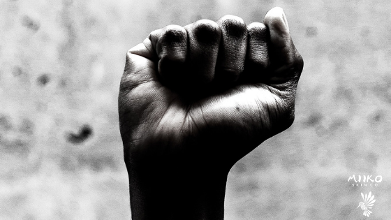 Black and white image of fist raised in the air