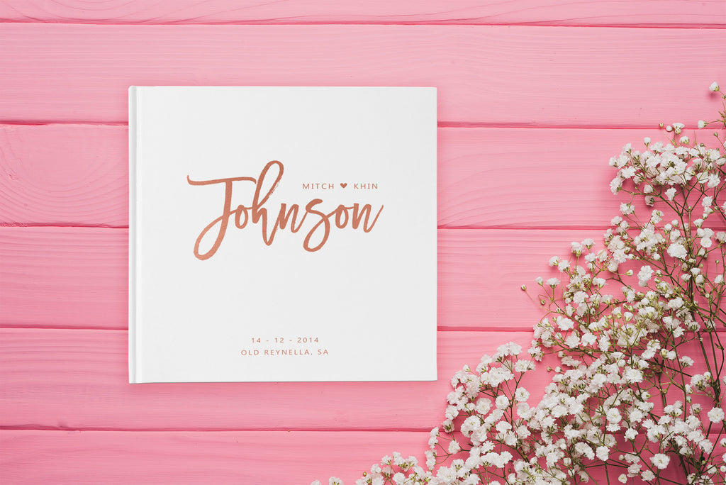 Rose gold and white wedding guest book