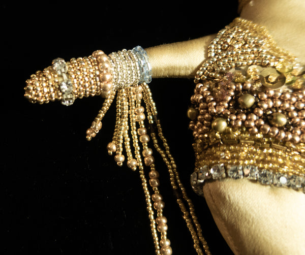 Beaded Doll with Gold Colored Beads