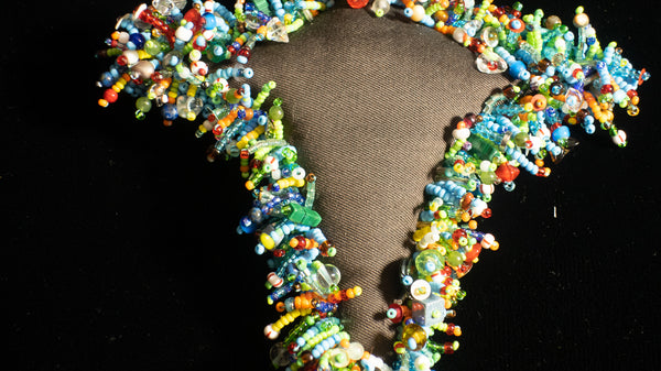 Beaded Doll with Turquoise Colored Glass Beads