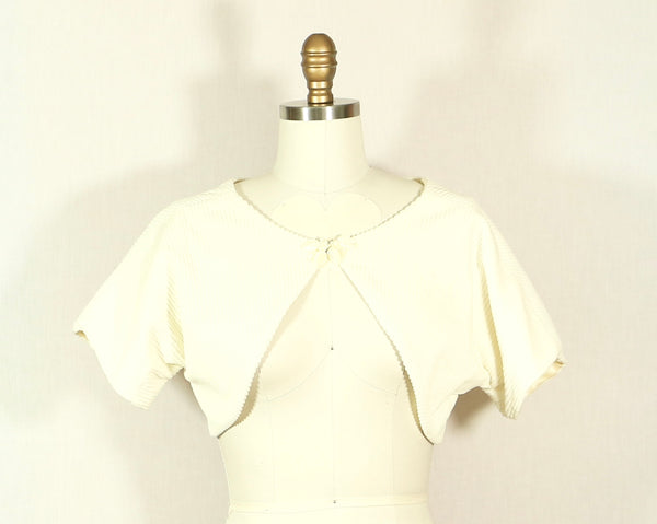 White Corduroy Shrug with Mother of Pearl Detail