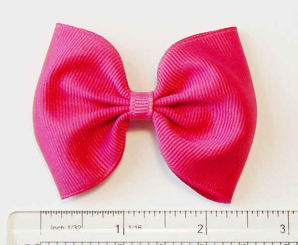 grosgrain hair bow (next to a ruler)