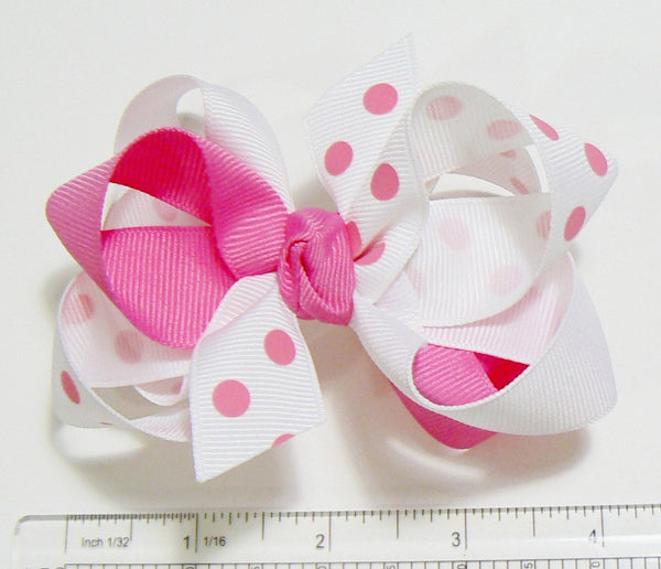 3-colored combination hair bow (next to ruler).