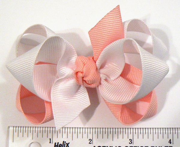 2-colored combination hair bow (next to ruler)