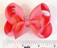 small hair bow (next to a ruler)