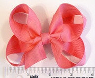 medium hair bow (next to ruler)