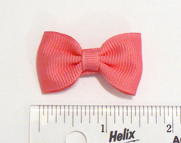 Infant girls hair bow (next to ruler)
