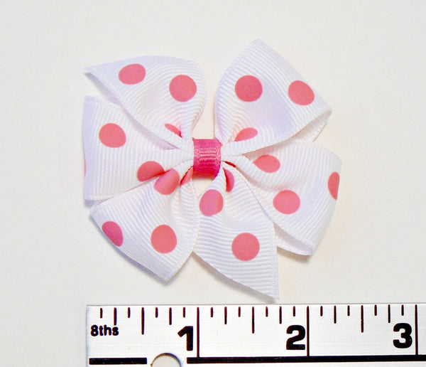 polka-dot hair bow (next to ruler)