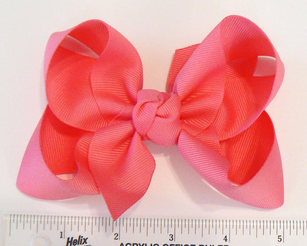 large hair bow (next to a ruler)