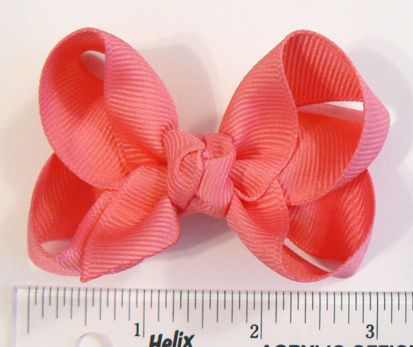 hair bow (next to a ruler)