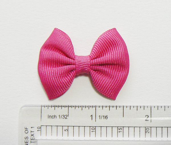 small girls hair bow (next to ruler)