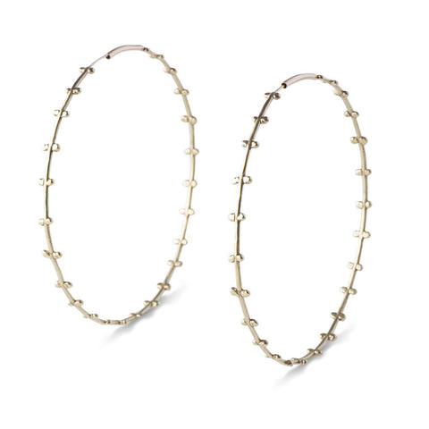 "3.25"" lightweight bronze hoops with small spherical details running along both sides. Made with gold ear wires to protect those sensitive to base metal."