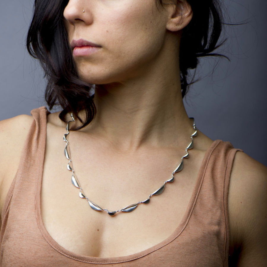 Handmade, sculptural sterling silver chain linked necklace. Designed and crafted by Sky Phaebl