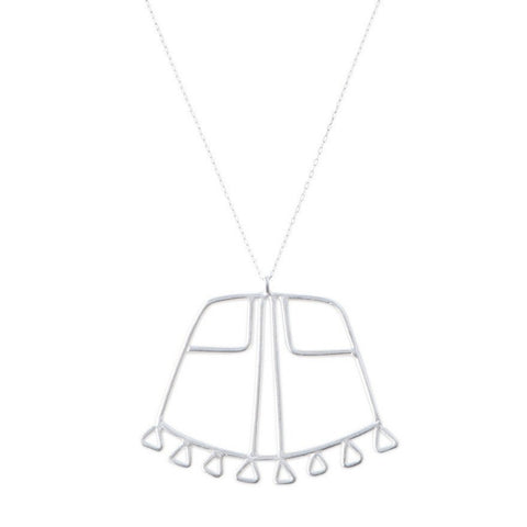 Close up of Sky Phaebl sterling silver curved trapezoid pendant lined with fixed triangular fringe along the base, featuring linear filigree inner detail. Pendant hangs on delicate silver chain.