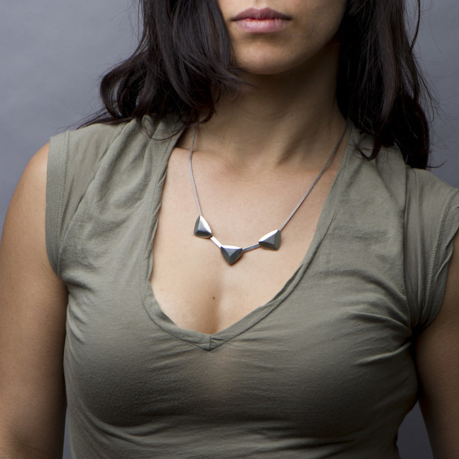 Handmade luxury. Sky Phaebl sterling silver sculptural statement necklace. Organic and refined.