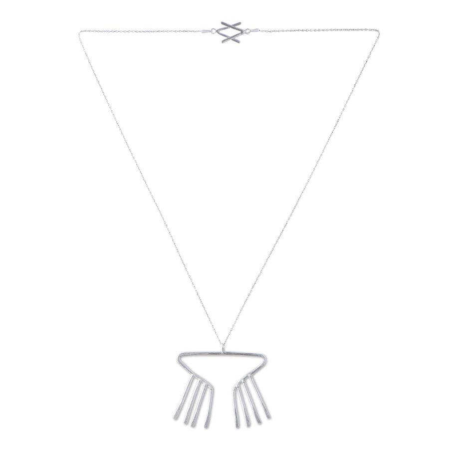 Sky Phaebl's sterling silver necklace. Open triangular pendant with fixed fringe and slight hammer texture. On delicate chain with signature V clasp.
