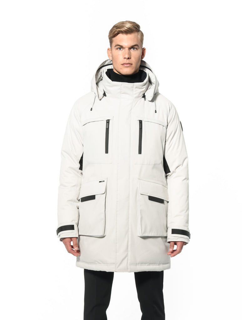 Men's thigh length down-filled parka with removable hood and removable coyote fur trim in Chalk| color