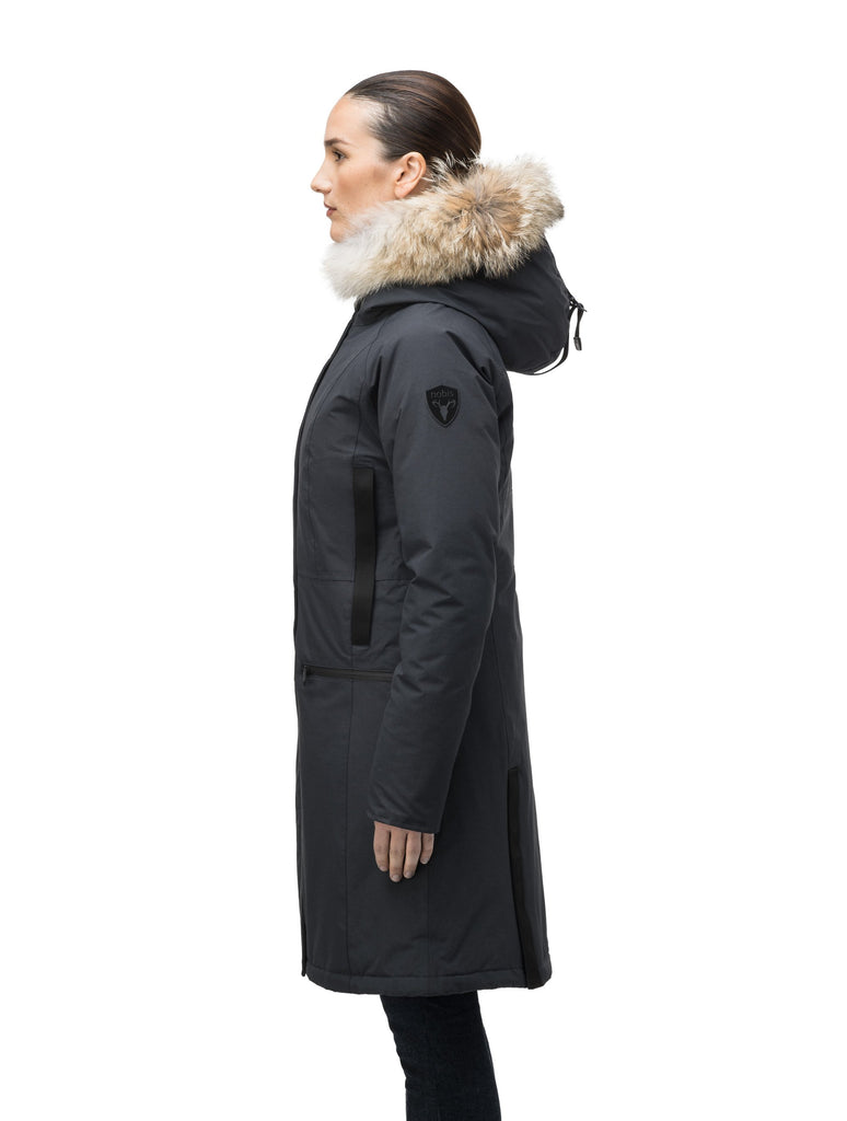 Knee length women's down filled parka with contrast ribbon accents and removable fur trim on the hood in Black| color