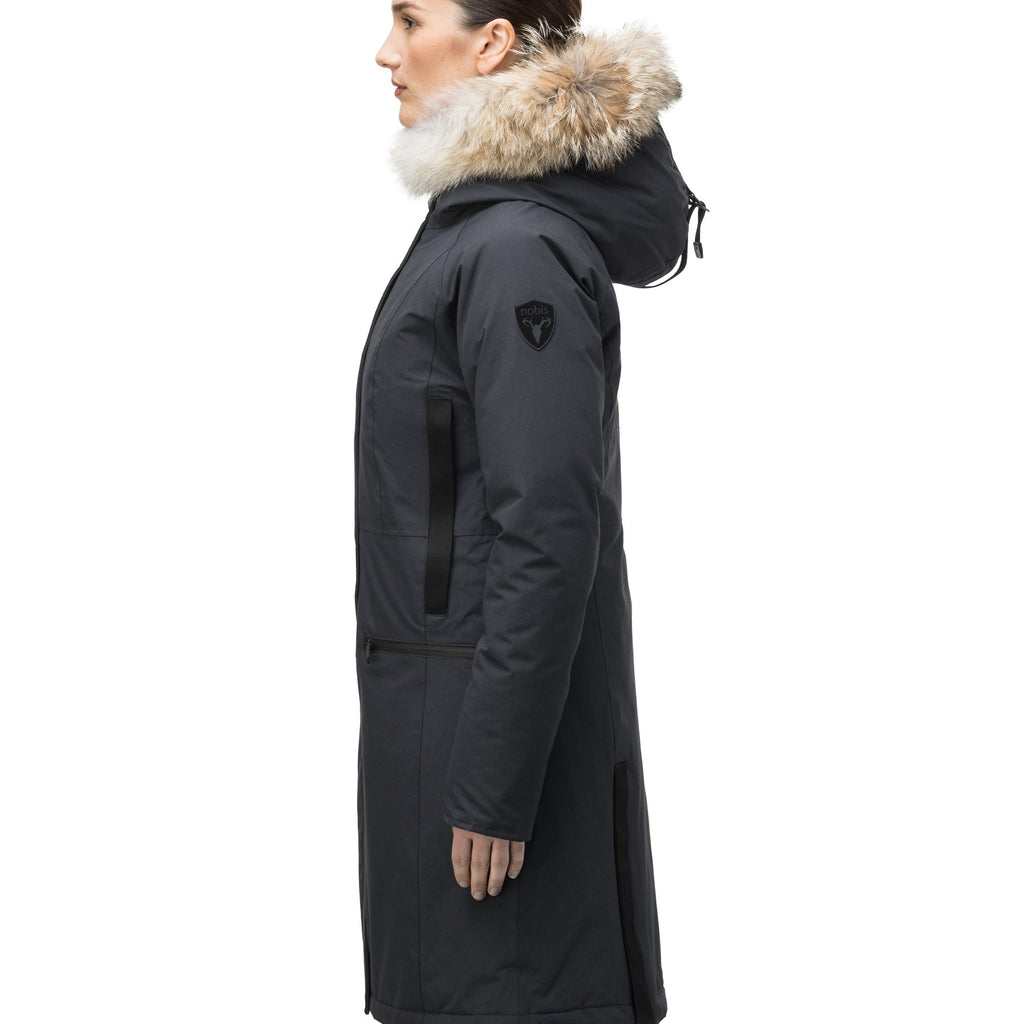 Knee length women's down filled parka with contrast ribbon accents and removable fur trim on the hood in Black | color