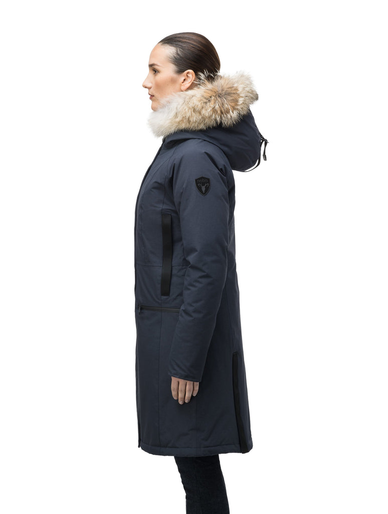 Knee length women's down filled parka with contrast ribbon accents and removable fur trim on the hood in Navy| color
