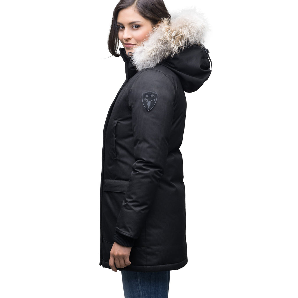 Women's down filled parka that sits just below the hip with a clean look and two hip patch pockets in CH Black | color