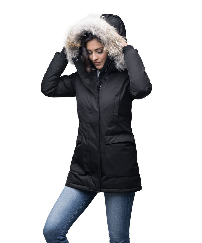 Women's down filled parka that sits just below the hip with a clean look and two hip patch pockets in CH Black| color