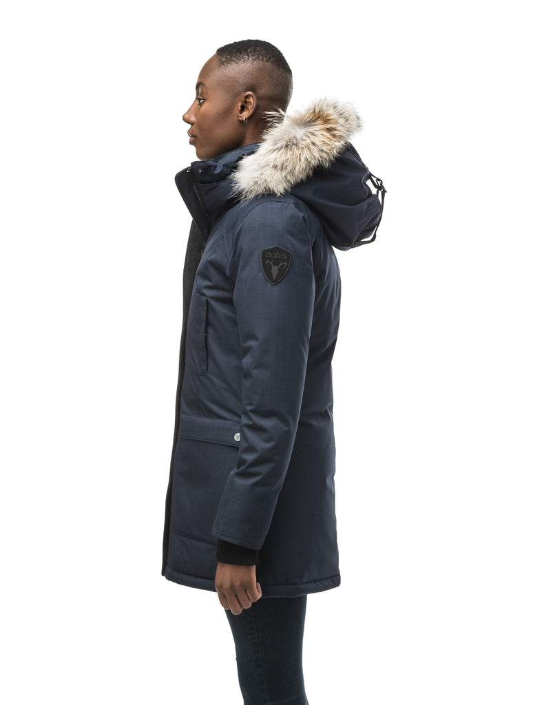 Women's down filled parka that sits just below the hip with a clean look and two hip patch pockets in CH Navy| color