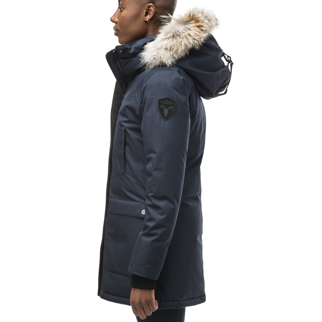 Women's down filled parka that sits just below the hip with a clean look and two hip patch pockets in CH Navy | color