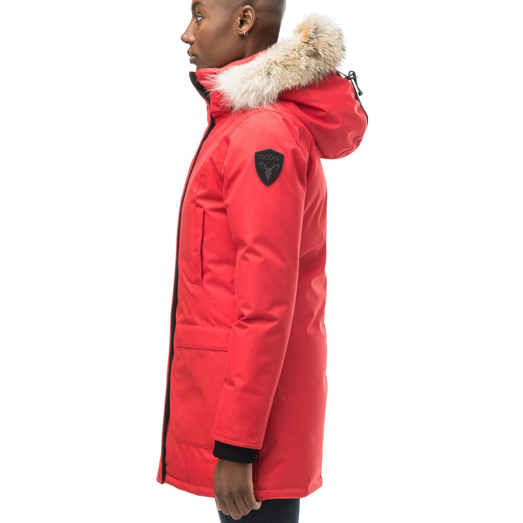 Women's down filled parka that sits just below the hip with a clean look and two hip patch pockets in CH Red | color