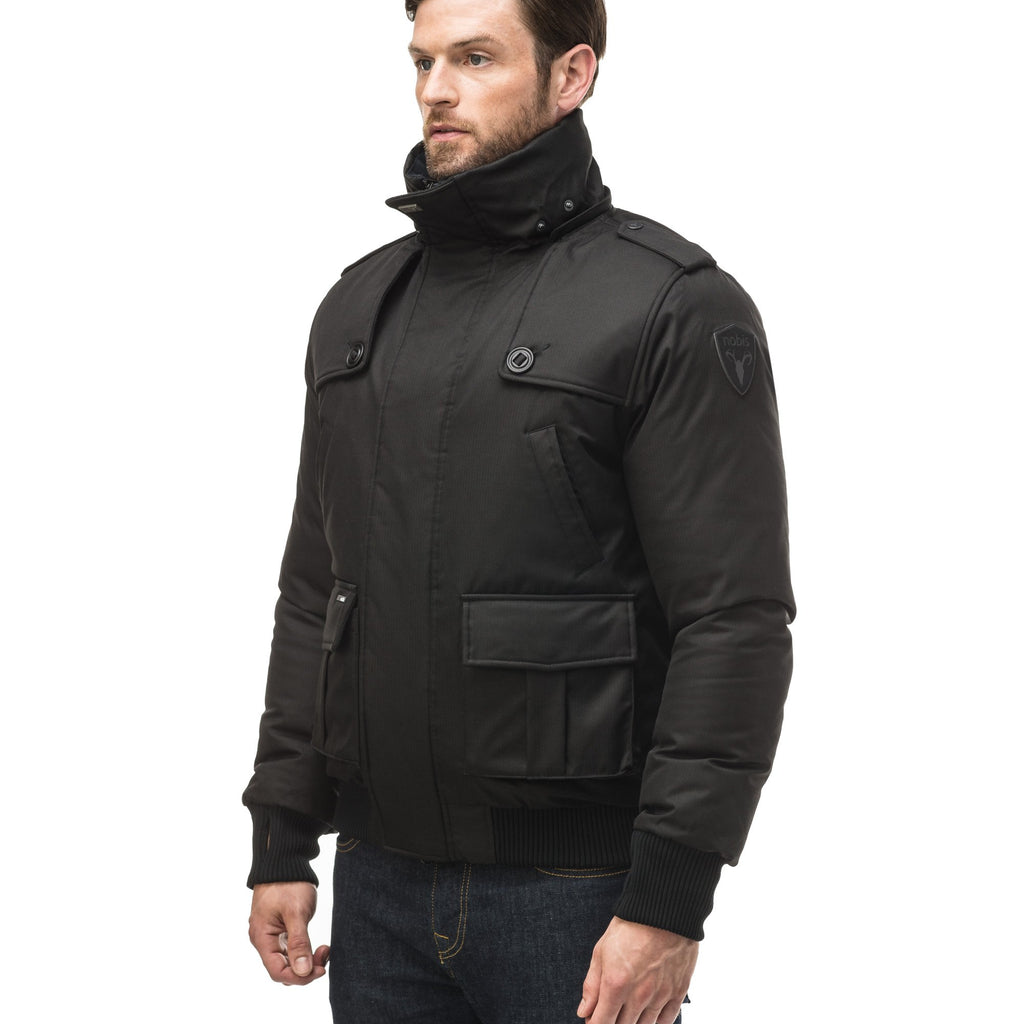 Men's down filled bomber that sits just above the hips with a completely removable hood that's windproof, waterproof, and breathable in Black | color
