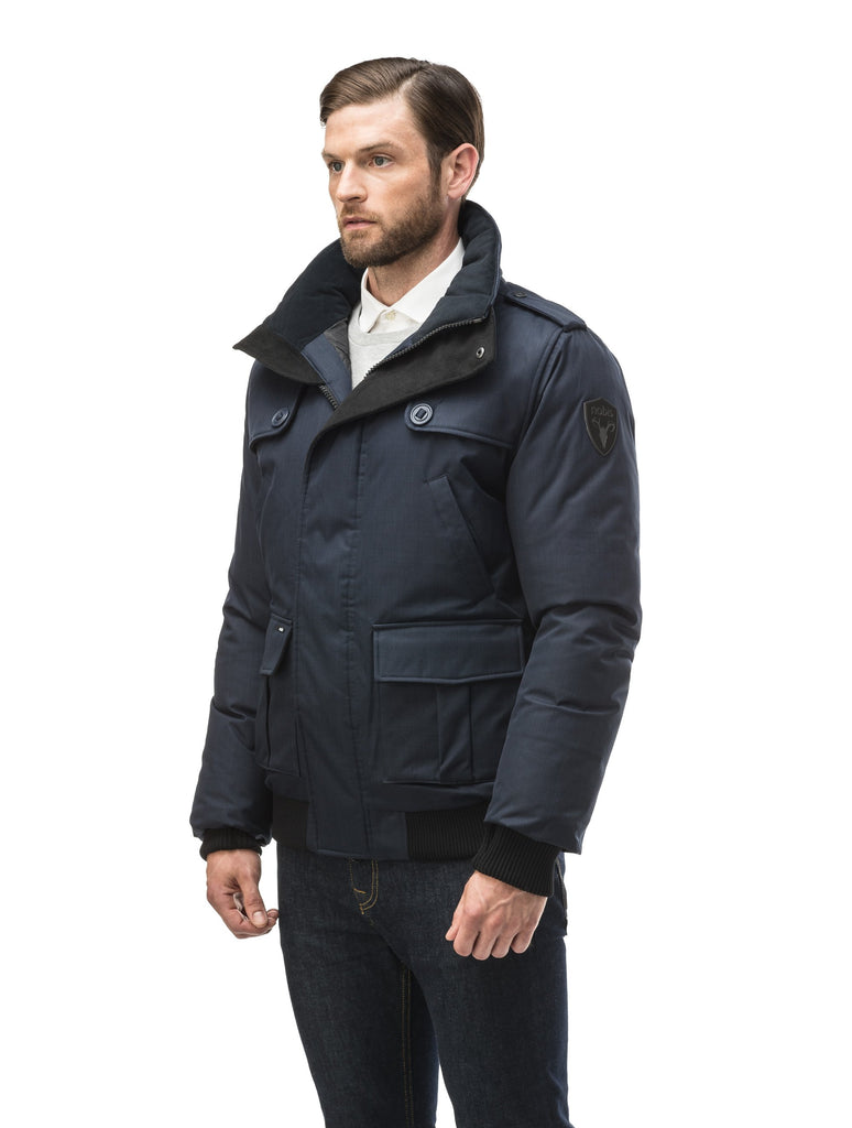 Men's down filled bomber that sits just above the hips with a completely removable hood that's windproof, waterproof, and breathable in CH Navy| color