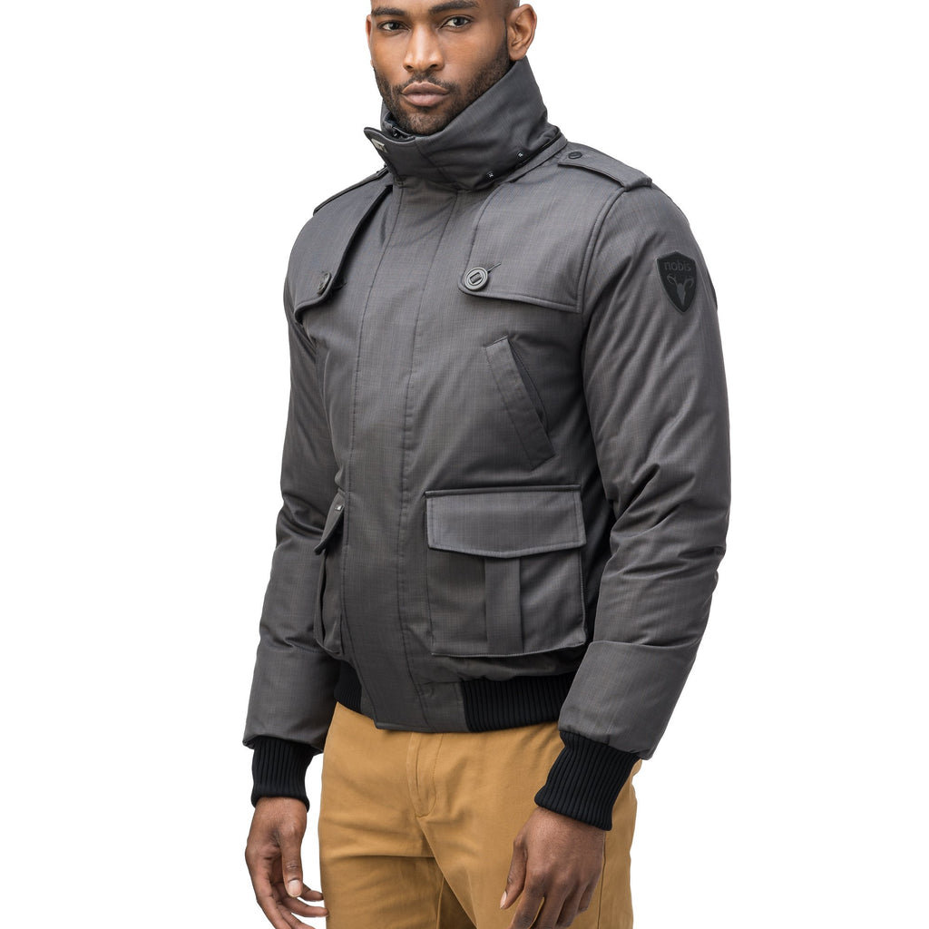 Men's down filled bomber that sits just above the hips with a completely removable hood that's windproof, waterproof, and breathable in CH Steel Grey | color