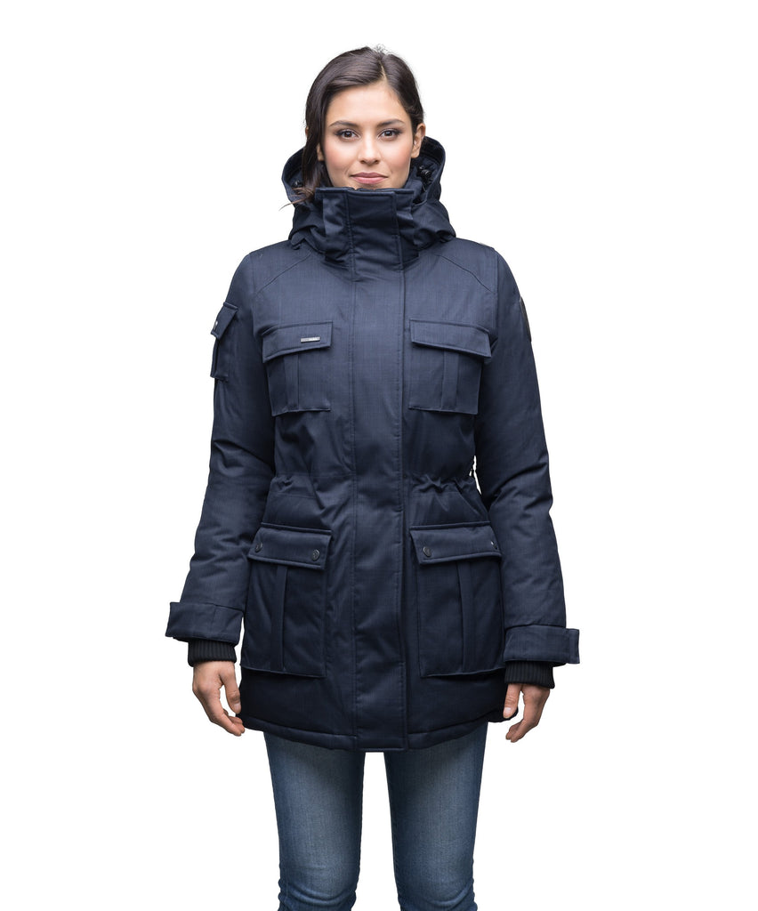 Women's down filled thigh length parka with four pleated patch pockets and an adjustable waist in CH Navy| color