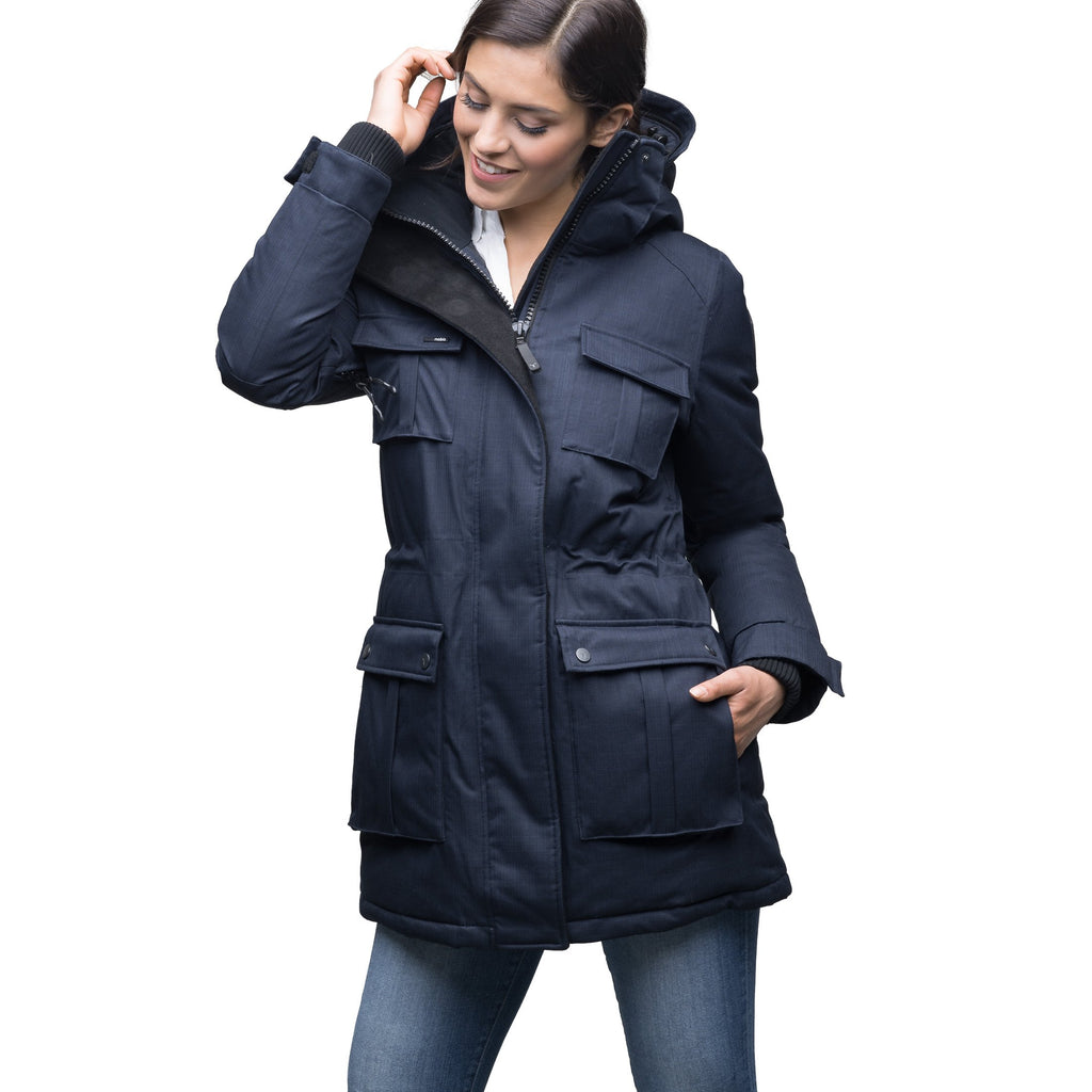 Women's down filled thigh length parka with four pleated patch pockets and an adjustable waist in CH Navy | color