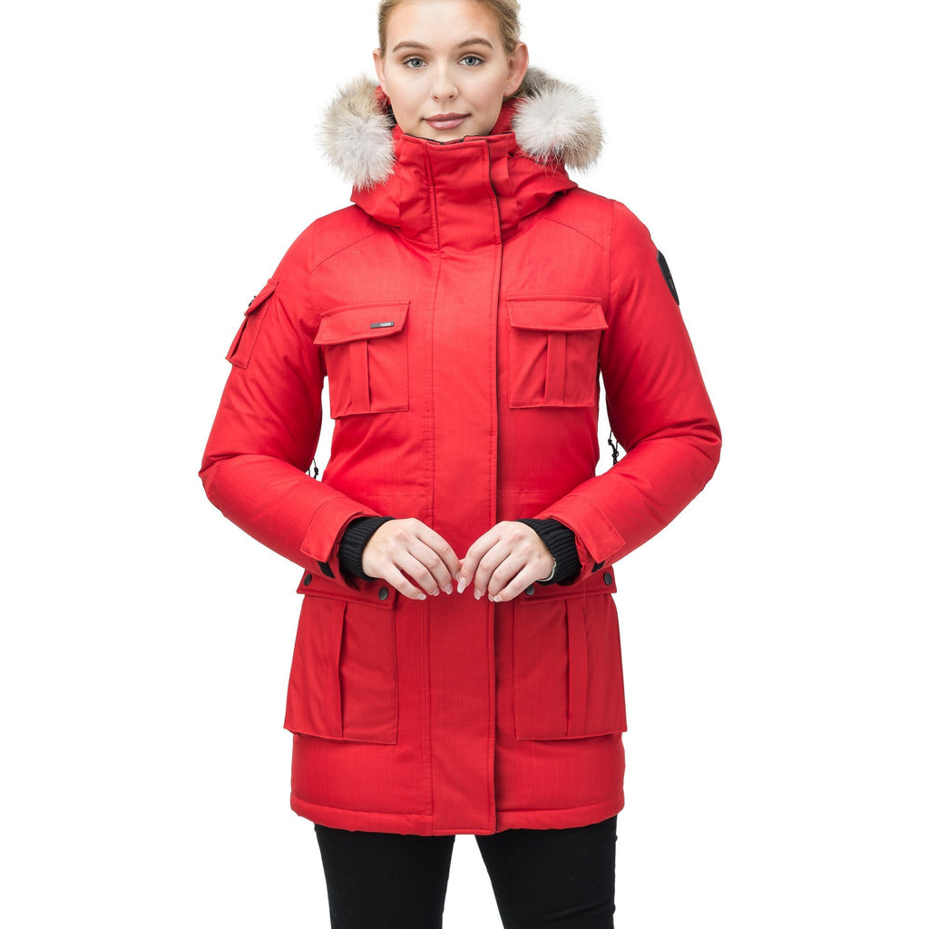 Women's down filled thigh length parka with four pleated patch pockets and an adjustable waist in CH Red | color