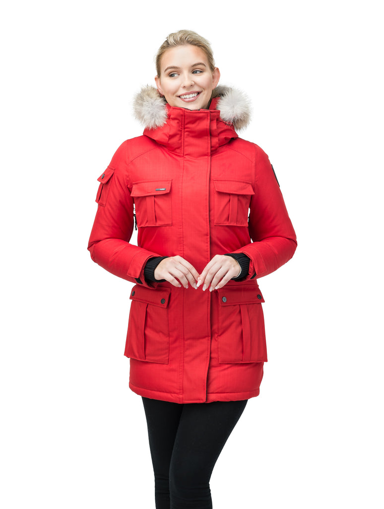 Women's down filled thigh length parka with four pleated patch pockets and an adjustable waist in CH Red