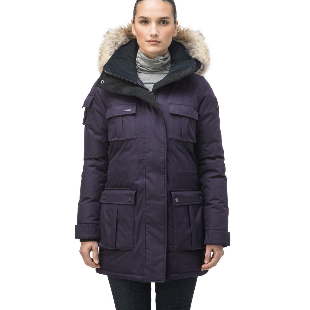 Women's down filled thigh length parka with four pleated patch pockets and an adjustable waist in CH Purple | color