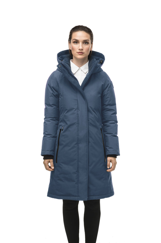 Minimalist down filled women's parka with fur free attached hood in Marine| color