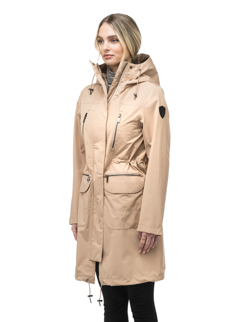 Women's knee length anorak with four front pockets and adjustable cord waist in Fawn| color