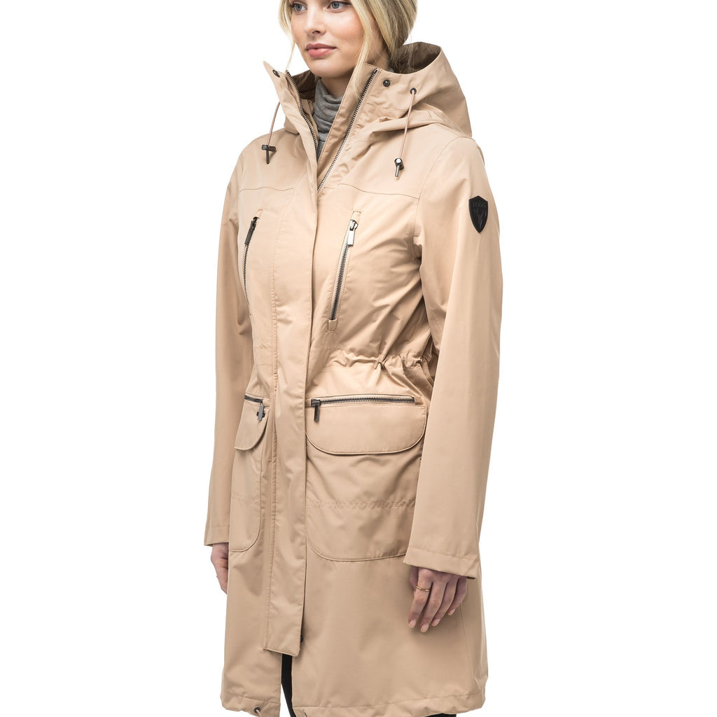 Women's knee length anorak with four front pockets and adjustable cord waist in Fawn | color