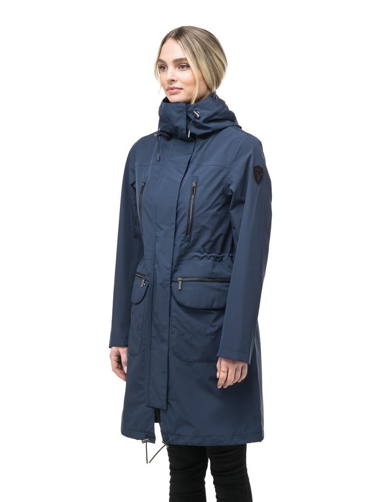 Women's knee length anorak with four front pockets and adjustable cord waist in Marine| color