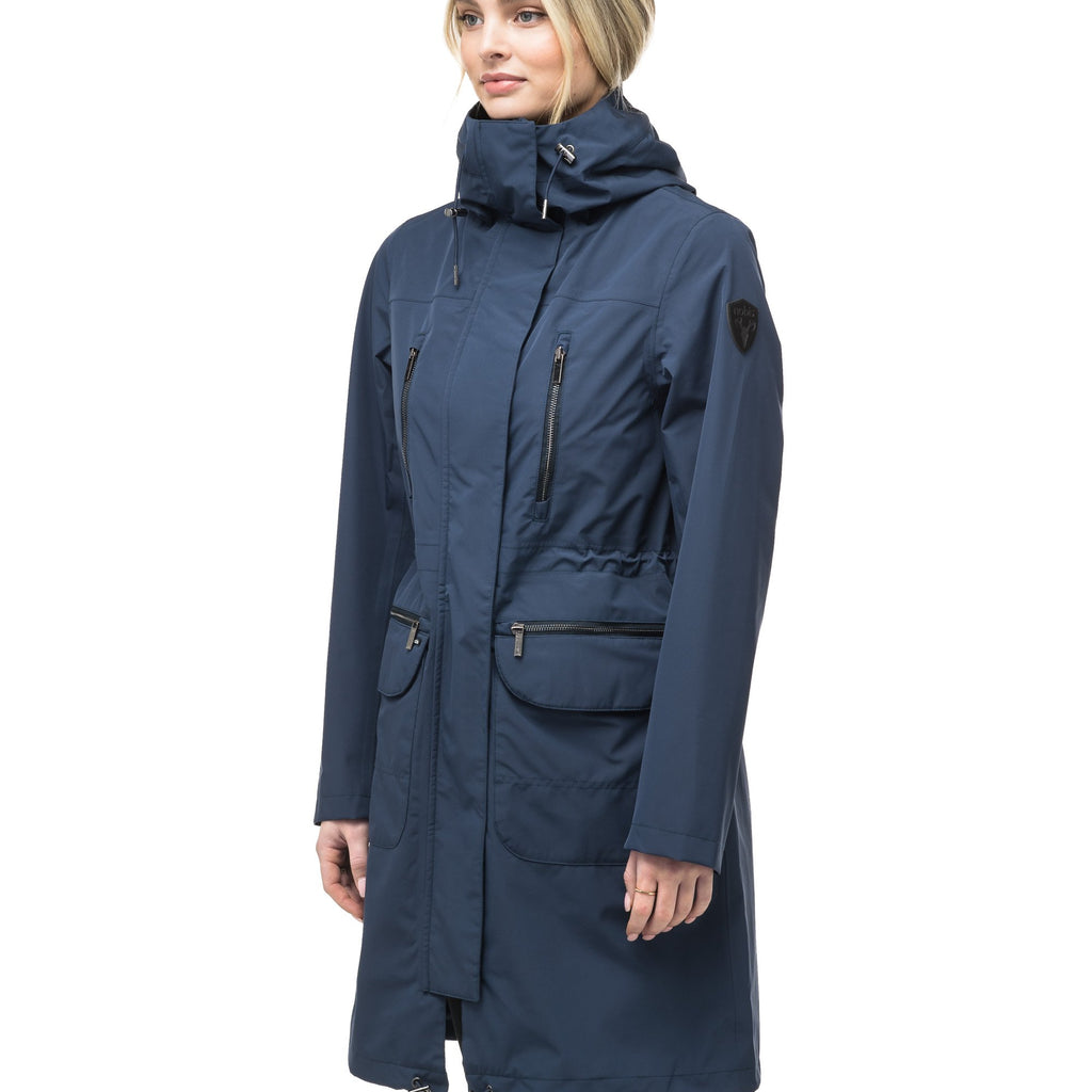 Women's knee length anorak with four front pockets and adjustable cord waist in Marine | color
