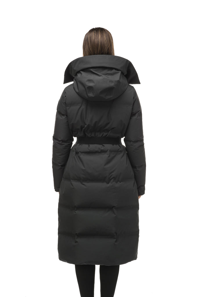 Women's ankle length puffer jacket with a minimalist modern design, featuring an exposed zipper, and seamless puffer channels in Black| color