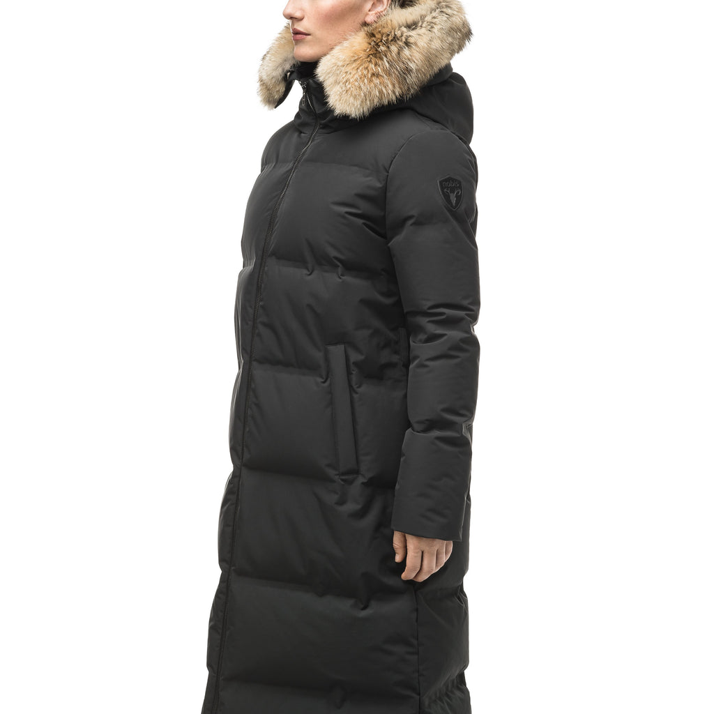 Women's ankle length puffer jacket with a minimalist modern design, featuring an exposed zipper, and seamless puffer channels in Black | color