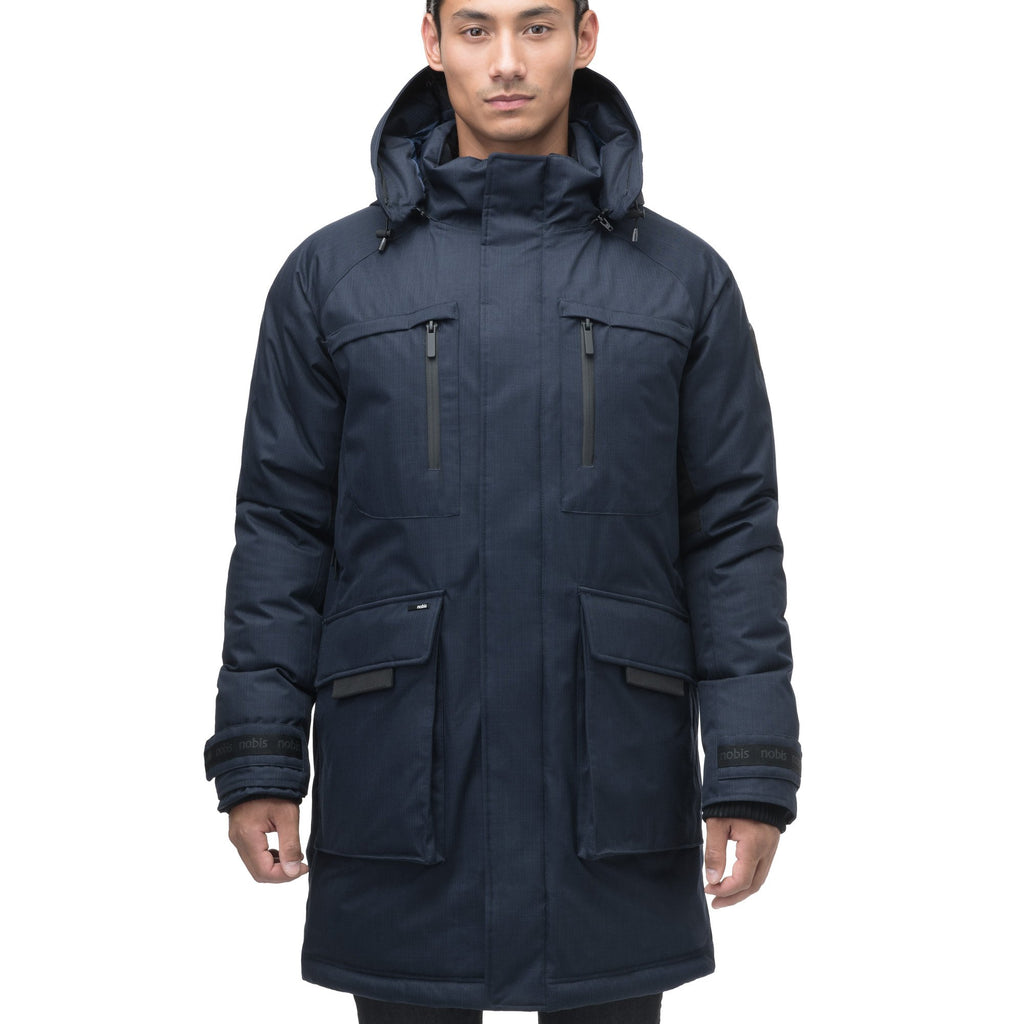 Men's thigh length down-filled parka with removable hood and removable coyote fur trim in Navy | color